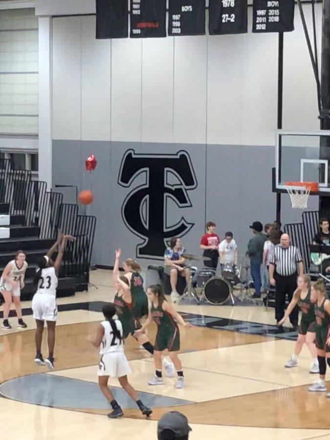 Senior, Elaiyah Badger, shoots the basketball.
