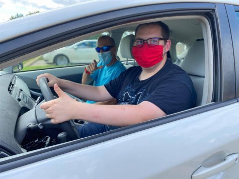 An unknown client and driving instructor, Jim Wooldridge, head off campus for a day of learning the roads.