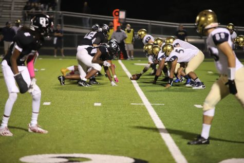 Photo taken by Nathan Torres. Both teams line up for a play during the game.