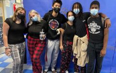 Photo taken by Brandi Jones. Students gather wearing pajamas in front of the senior hallway for spirit week.