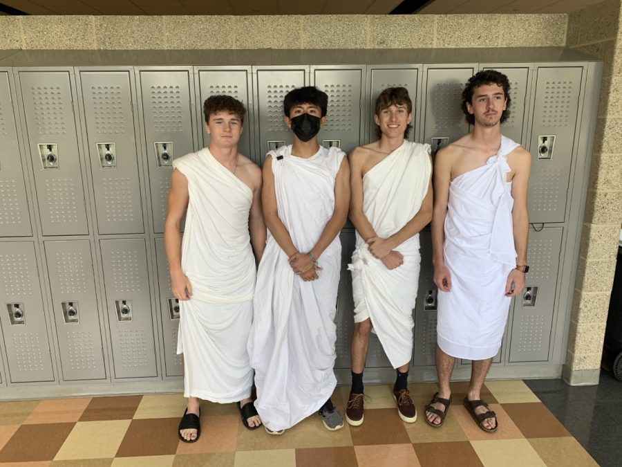 Picture taken by Mark Lenzini, CCHS students (from left to right) William Skiles, Timothy Lin, Matthew Nadolski, and Cameron Tabor pose for a picture in their togas.